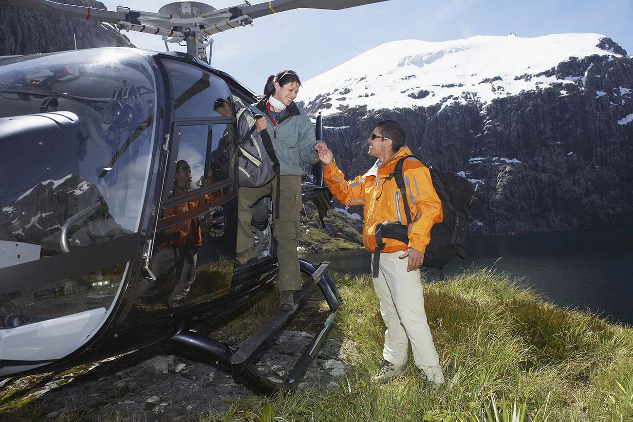 Hikersclimbingoutofhelicopteronmountaintop2